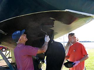 yacht Banyandah applying antifouling